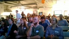 A captive audience watches the companies present at Start Houston's October Demo Day.