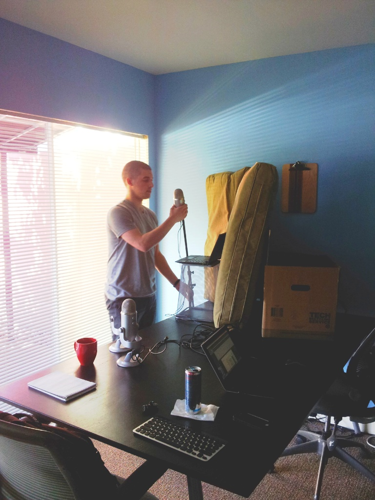 Nick setting up a mini recording studio inside the offices of January Advisers.